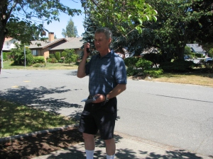 Mr. Joe Baxter helped with the leaflet drop. Here he is with the two-way radio checking the progress